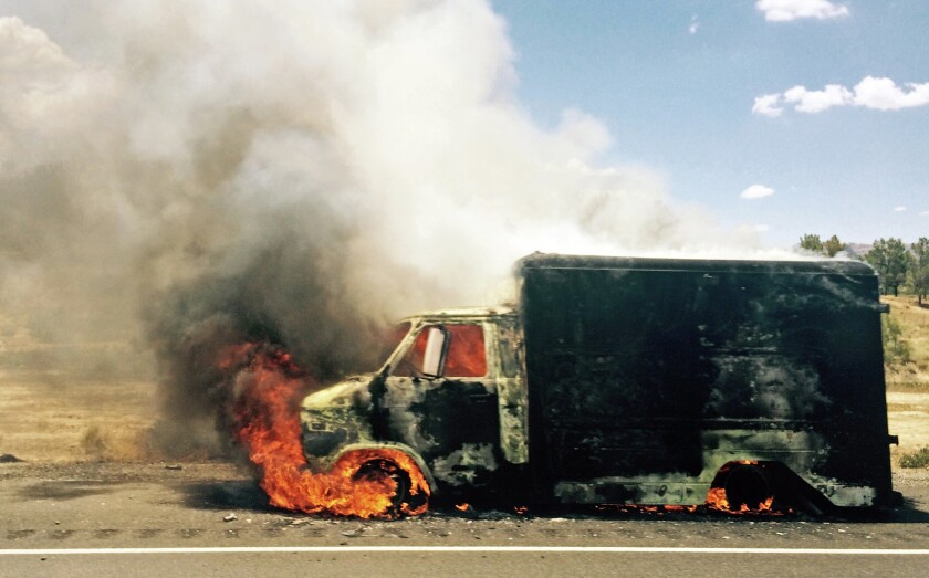 Smoke rises from a burning truck packed with fireworks after it exploded on Interstate 15 near Ivanpah, Calif., close to the Nevada state line.