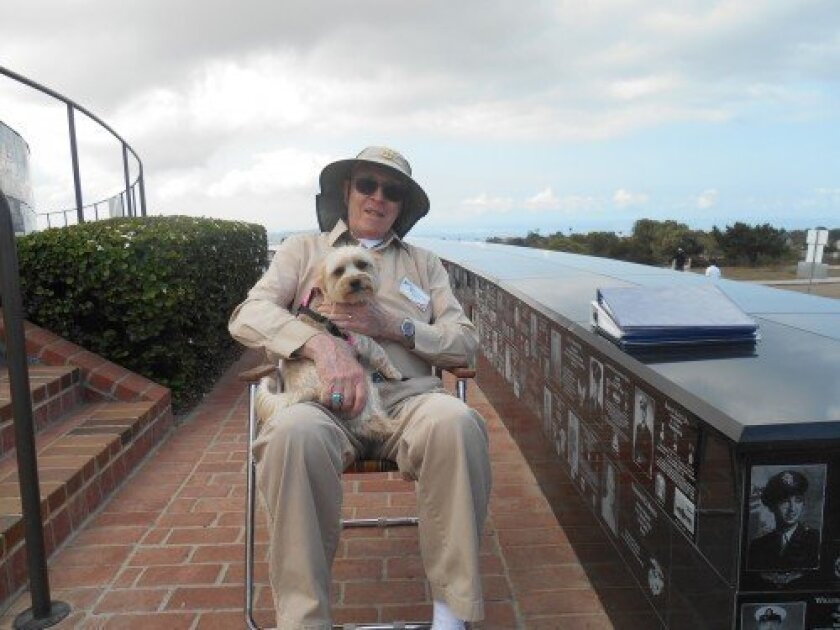 "Wilfred ""Bill"" Sturgeon, a longtime docent with the Mount Soledad Memorial Association, poses with frequent canine visitor, Chloe, and awaits visitors with questions about the site.  Courtesy"