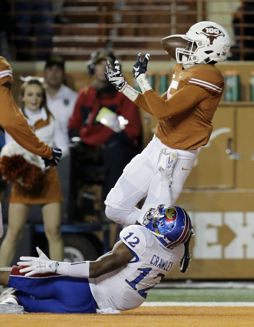 Texas defensive back Holton Hill (5) breaks up a pass intend for Kansas wide receiver Darious Crawley (12) during the first half of an NCAA college football game, Saturday, Nov. 7, 2015, in Austin, Texas. (AP Photo/Eric Gay)