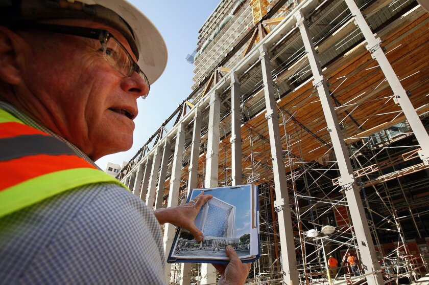 Clifford Ham, principal architect for the Judicial Council of California, holds an artist's rendering in front of what will be the front door view of the new courthouse, replacing the current one at 220 W. Broadway.