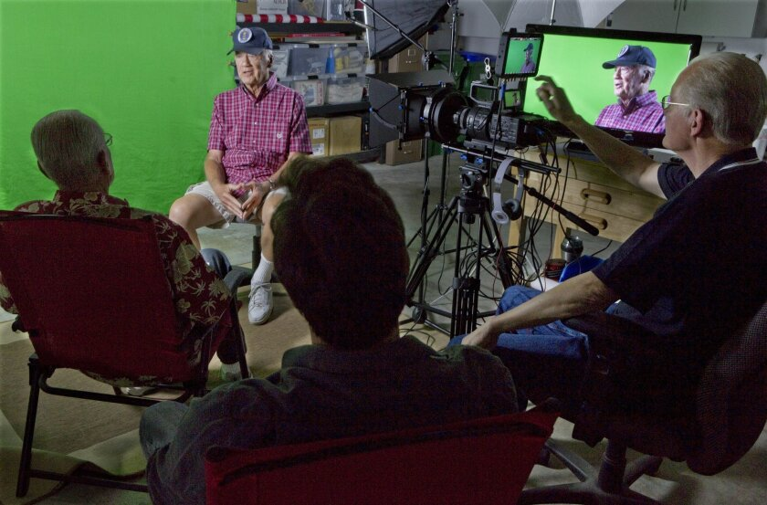 """Retired Air Force pilot Don Mulligan, second from left, is being interviewed by Robert Broughton, left, with producer George Dawe, center, and filmmaker Patrick Pranica in Pranica's Carlsbad garage video studio for the series """"Old Bold Pilots"""" on Friday. photo by Bill Wechter"""