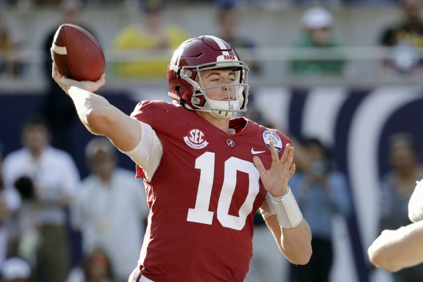 FILE- In this Jan. 1, 2020, file photo, Alabama quarterback Mac Jones (10) throws a pass during the second half of the Citrus Bowl NCAA college football game against Michigan in Orlando, Fla. Alabama quarterback Mac Jones and Auburn's Bo Nix have taken different paths to their starting jobs. Now, they'll lead their teams into the Iron Bowl for the second straight year. (AP Photo/John Raoux, File)