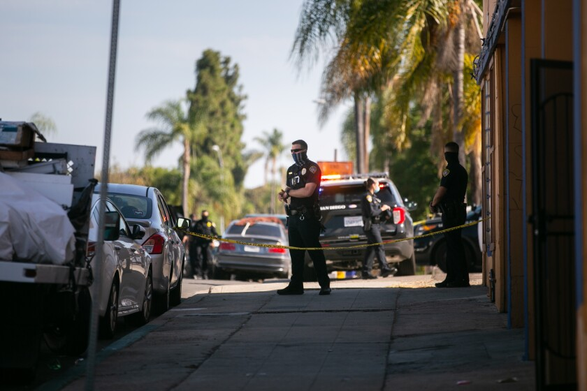 San Diego police officers respond to the scene of a police-involved shooting on Menlo Avenue last July.
