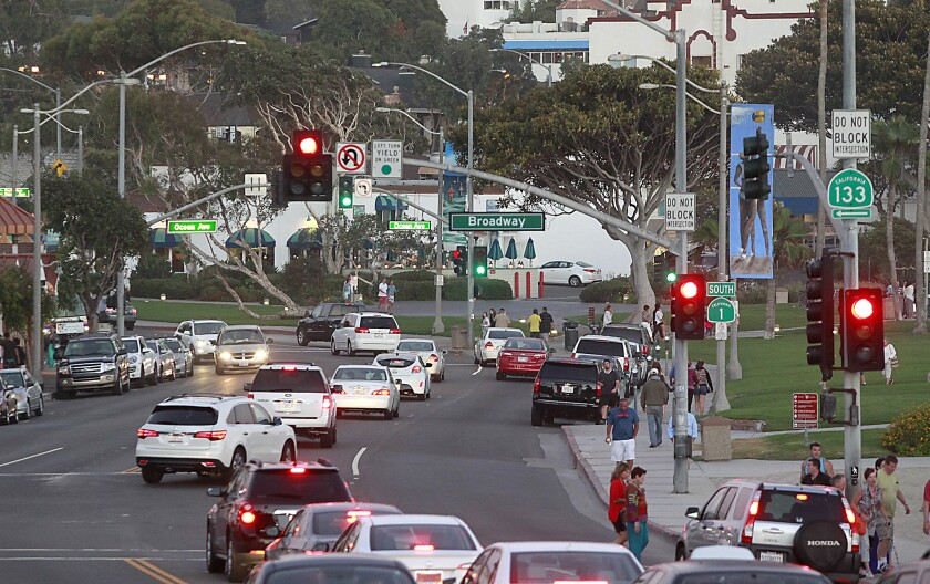 Cars pass through traffic near Broadway Street in Laguna Beach.