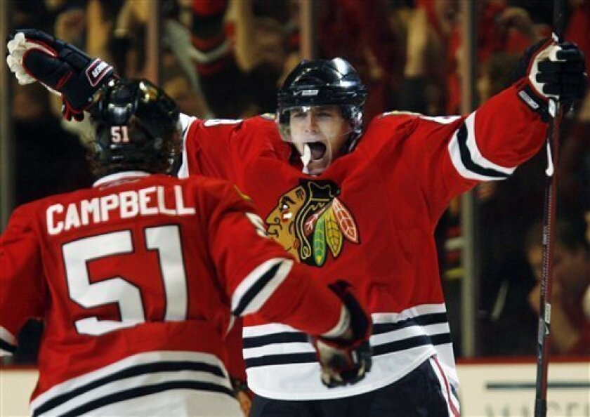 Chicago Blackhawks' Patrick Kane, right, celebrates with Brian Campbell after scoring his goal against the Vancouver Canucks during the third period of Game 6 of the NHL hockey Western Conference semifinal, Monday, May 11, 2009, in Chicago. The Blackhawks won 7-5. (AP Photo/Nam Y. Huh)