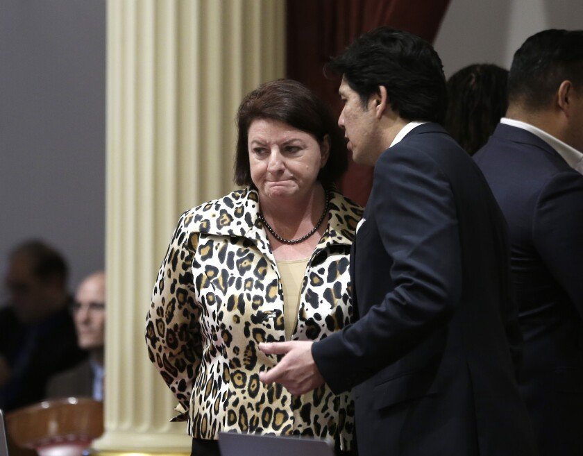 Assembly Speaker Toni Atkins talks with Senate President Pro Tem Kevin de León, who is standing firmly behind Sen. Marty Block in what could be a long and expensive fight