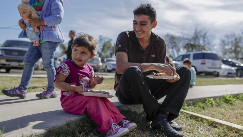 MCALLEN, TEXAS, SATURDAY, JANUARY 19, 2019 - Juan Pablo Lazo with his daughter Marjorie, 2, at the C