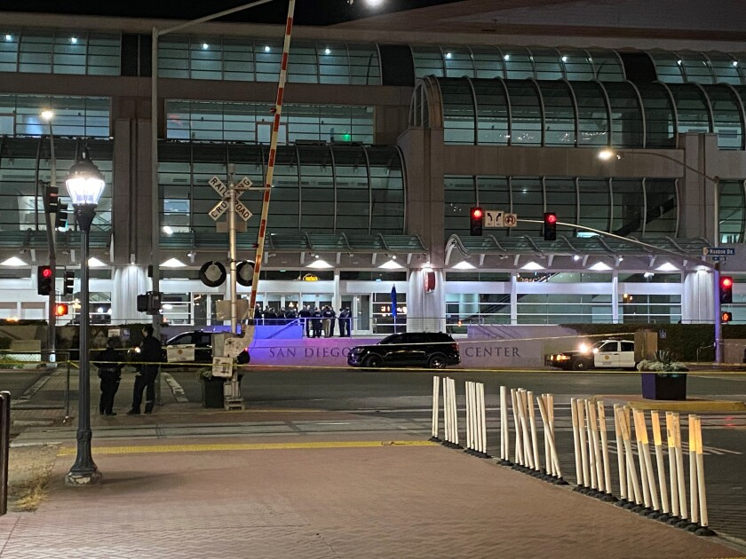 Police investigate shootout between Harbor Police Department officer and driver Monday outside San Diego Convention Center.