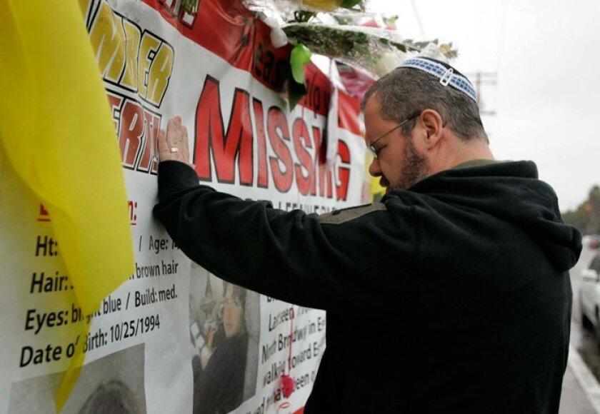 Mark Rantz of Escondido, a rabbinical intern at Kehilat Ariel Synagogue in Escondido, says the Mourners Kaddish, a memorial prayer, at the memorial to Amber Dubois in front of Escondido High School.