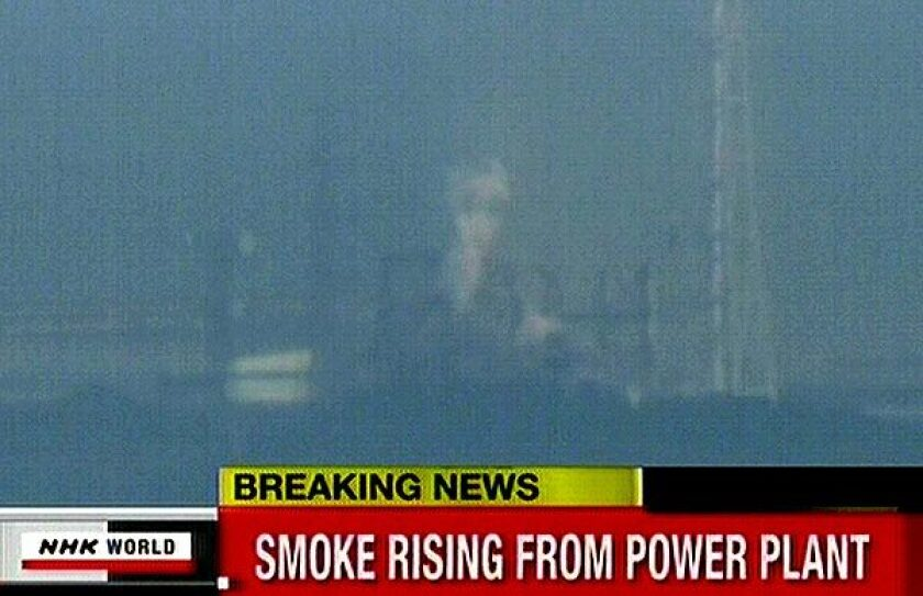 A screen grab from news footage shows white smoke rising from a new explosion at the Fukushima nuclear power station.