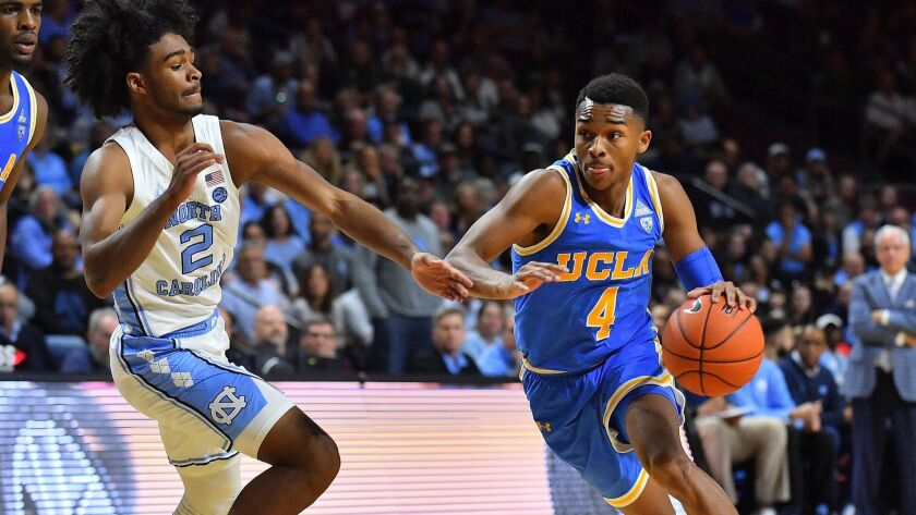UCLA's Jaylen Hands (4) drives against North Carolina's Coby White (2) at the Orleans Arena in Las Vegas on Nov. 23, 2018. North Carolina defeated UCLA 94-78.