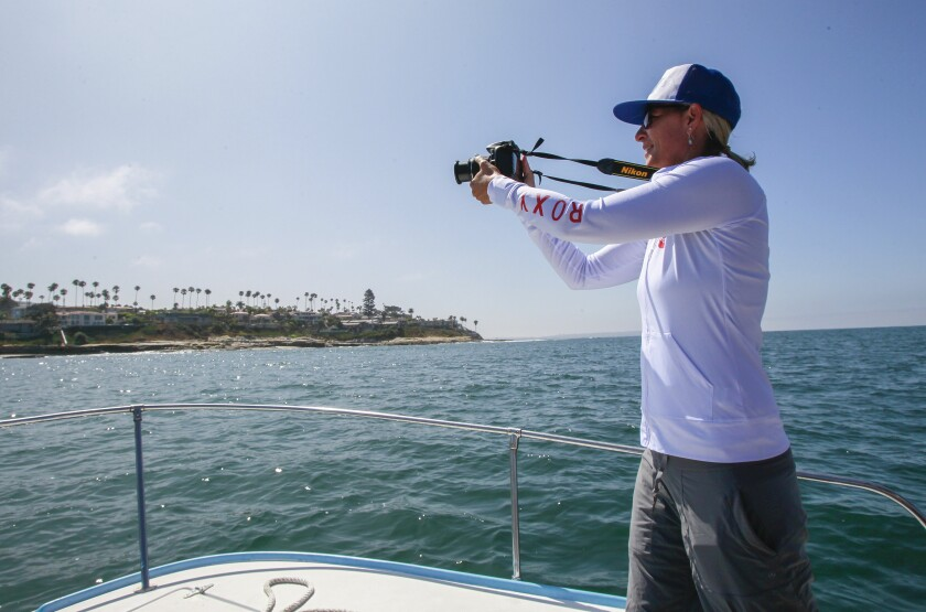 Calla Allison, MPA Collaborative Network director photographs a boundary line of the South La Jolla marine protected area on August 9, 2019 in San Diego, California.