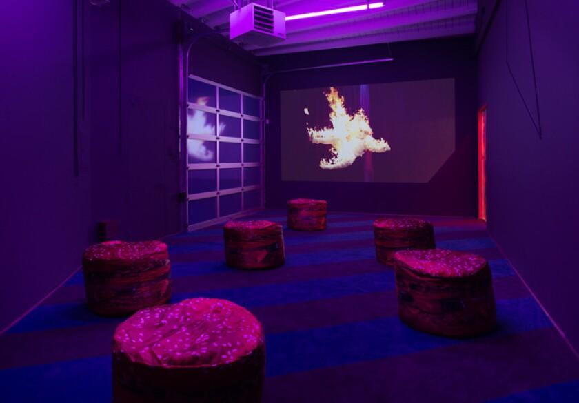 Hamburger ottomans provide seating in the final room of Alex Da Corte's installation