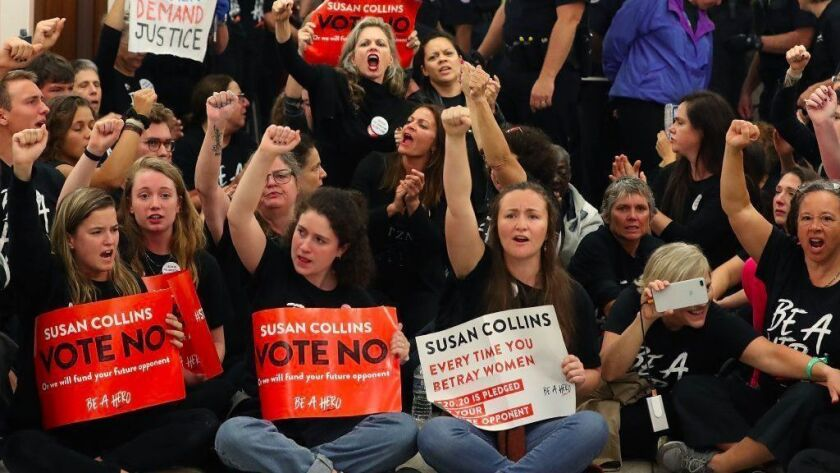 Protesters gather at the Capitol Hill office of Sen. Susan Collins (R-Maine) last week.