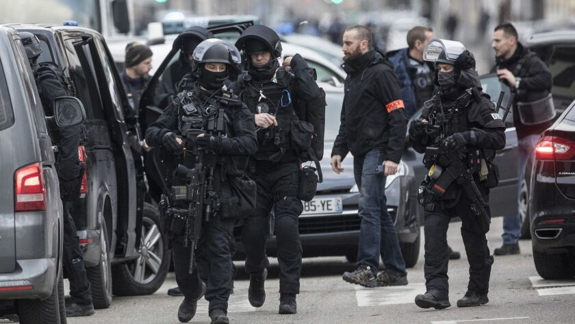 French police forces take position in the Neudorf district of Strasbourg, eastern France, Thursday,