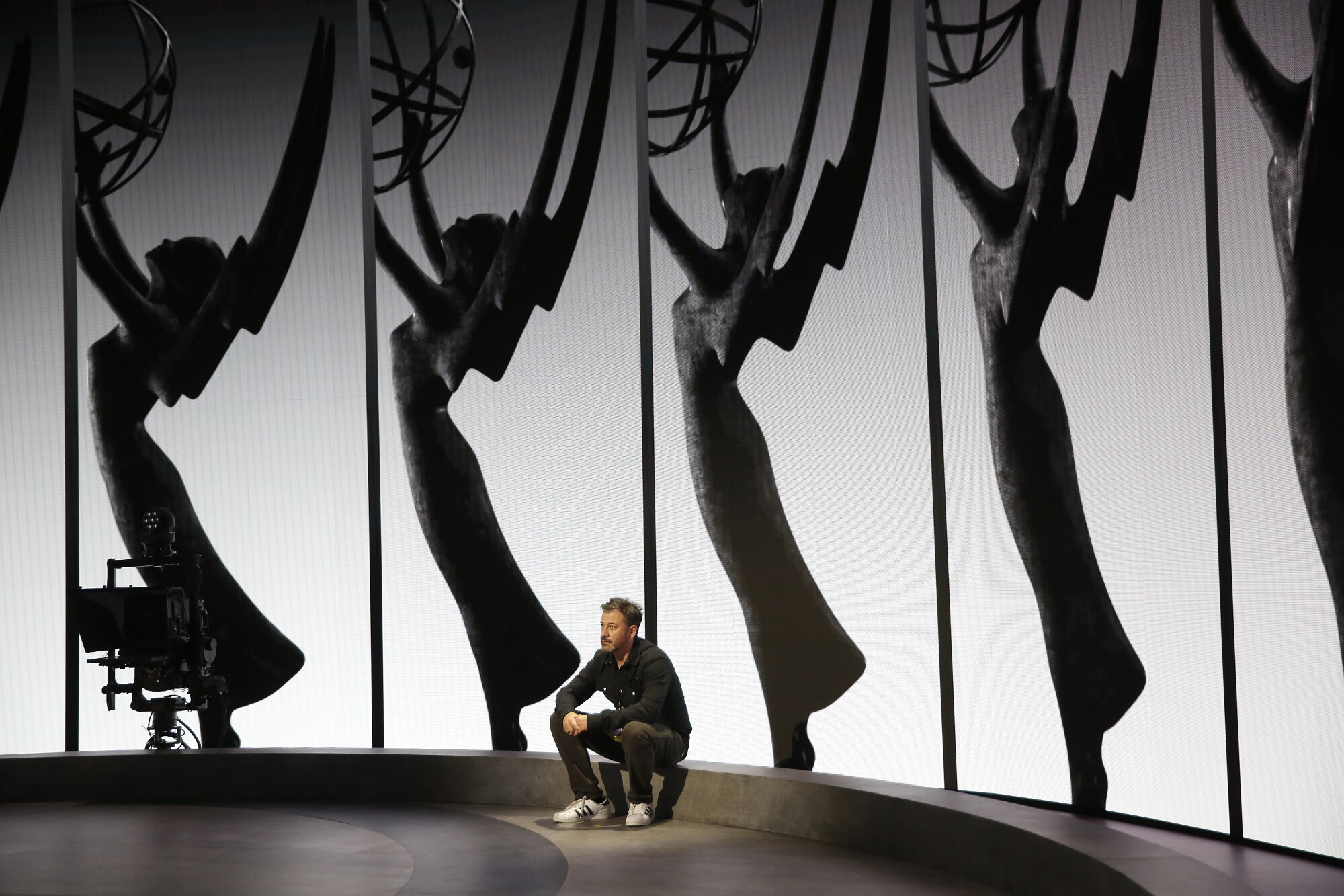 Emmy Host Jimmy Kimmel relaxes on the Emmy Awards stage.