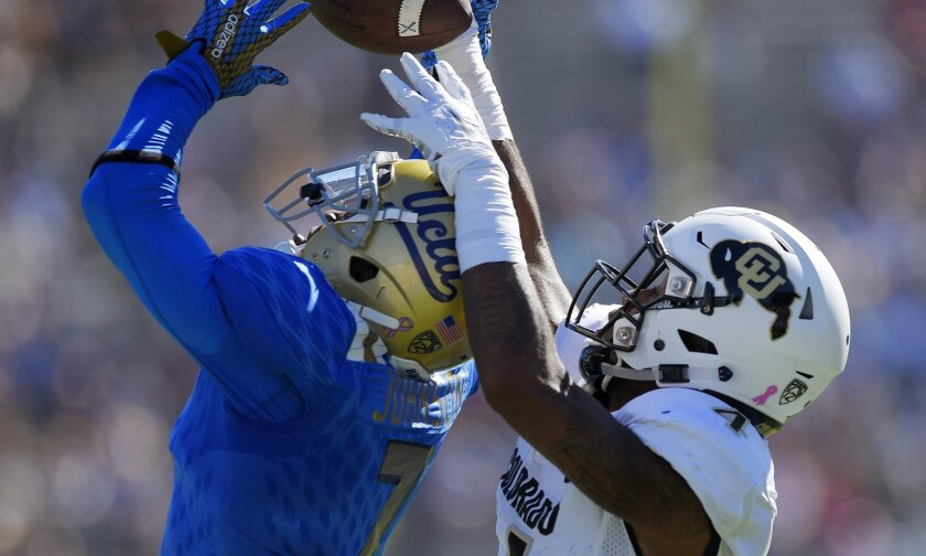 UCLA defensive back John Johnson, left, breaks up a pass intended for Colorado wide receiver Bryce Bobo the first half of an NCAA college football game, Saturday, Oct. 31, 2015, in Pasadena, Calif. (AP Photo/Mark J. Terrill)