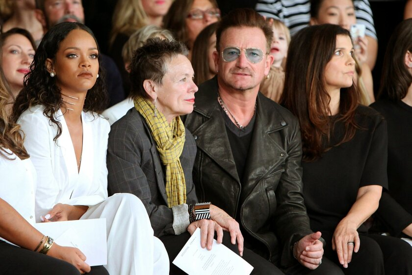 In this image released by Starpix, Rihanna, from left, Laurie Anderson, Bono and Ali Hewson sit in the front row at the Edun Spring 2015 collection, Sunday, Sept 7, 2014, during Fashion Week in New York. (AP Photo/Starpix, Kristina Bumphrey)