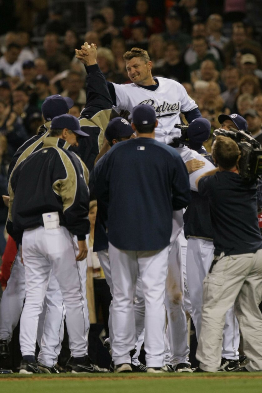 Pitcher Trevor Hoffman is congratulated on his 500th save by his San Diego Padres teammates.