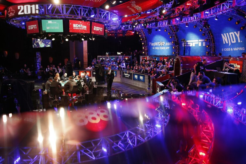 Play begins at the final table of the World Series of Poker Sunday, Nov. 8, 2015, in Las Vegas. Sunday night was the first of three days of poker-playing before crowning a new champion and awarding more than $7 million to the winner. (AP Photo/John Locher)