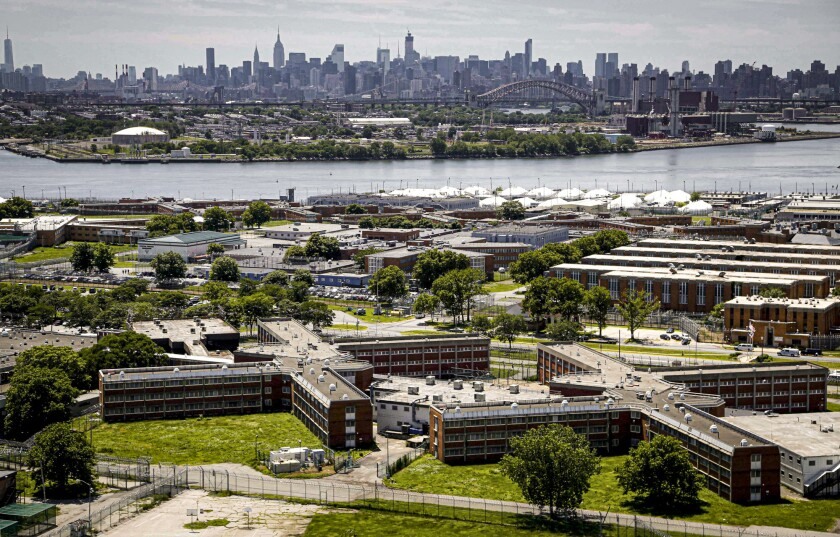 FILE - This Tuesday Dec. 2, 2014, file photo shows the Rikers Island jail complex in the foreground within the East River and the New York skyline in the background. Nearly all female and transgender inmates at New York City's Rikers Island jail complex will be moved to state lockups in nearby Westchester County to relieve strain on the city's failing jails, Gov. Kathy Hochul said Wednesday, Oct. 13, 2021.(AP Photo/Seth Wenig, File)