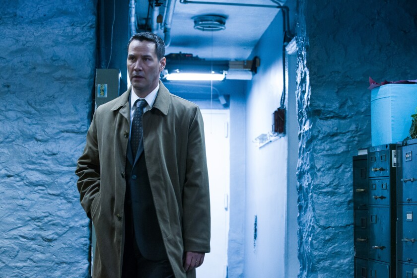"Keanu Reeves stars as a detective in the supernatural crime thriller ""Exposed."""