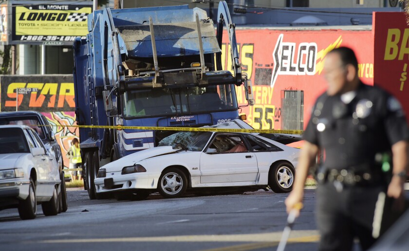 In discussing the dangerous habits of drivers and pedestrians, City Council members were told Wednesday that 225 people a year die on Los Angeles streets -- half of them cyclists and pedestrians. Above, the scene of a fatal crash in El Sereno.