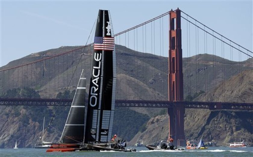 Oracle Team USA practices near the Golden Gate Bridge prior to the 16th race of the America's Cup sailing event Monday, Sept. 23, 2013, in San Francisco. (AP Photo/Ben Margot)