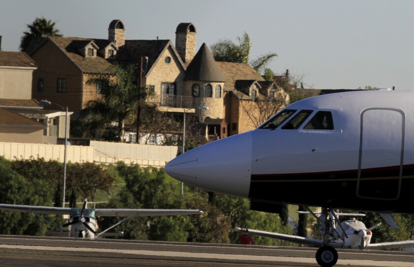 A corporate jet taxis into position at Santa Monica Airport, which must stay open until 2023 under a new ruling.