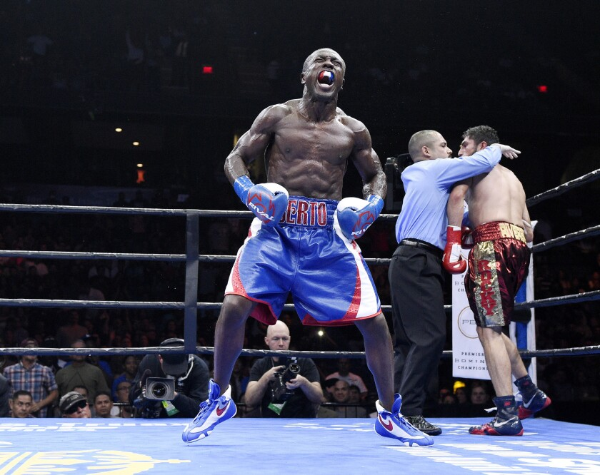Andre Berto celebrates after knocking out Josesito Lopez in the sixth round of their welterweight bout at Citizens Business Bank Arena on March 13.