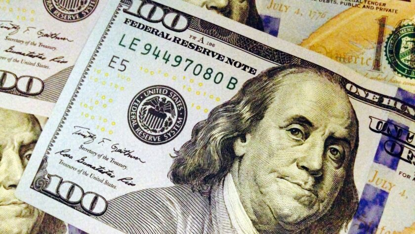 FILE - This Feb. 2, 2015, file photo, depicts a part of a U.S. $100 bill. A new government report es