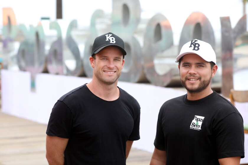 Chris Den Uijl, left, and Aaron Ampudia, co-founders of Baja Beach Fest 2019, at Papas & Beer on Aug. 7 in Rosarito, Mexico.