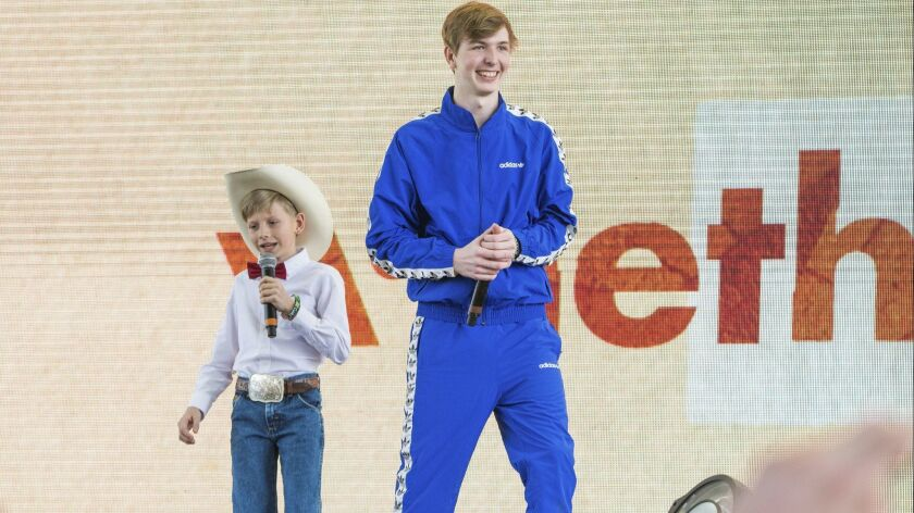Yodeler Mason Ramsey, left, and electronic dance artist Whethan perform Friday at the Coachella Valley Music and Arts Festival.