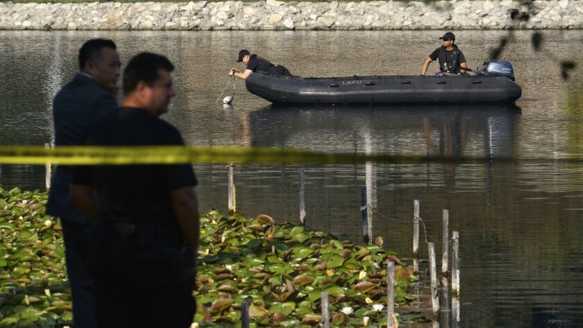 Los Angeles Police Department dive team members use sonar to search the bottom of Echo Park Lake nea