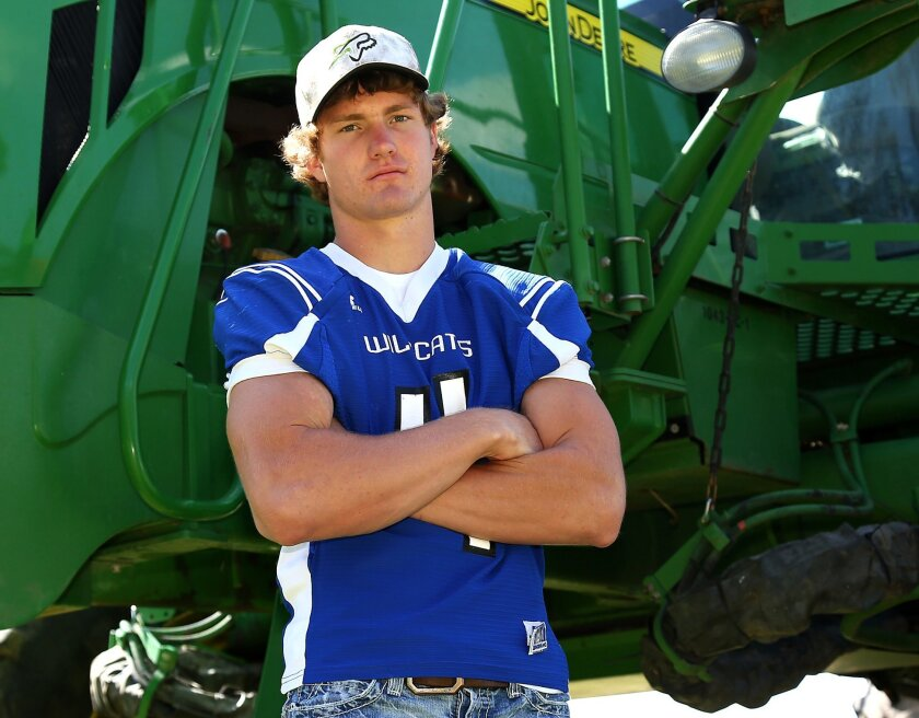 This May 16, 2015 photo provided by Everett Royer shows Luke Schemm near Atwood, Kan. The Kansas high school football player has been declared brain-dead according to a hospital spokeswoman at a Colorado hospital after collapsing on the sideline during a state playoff game Tuesday, Nov. 3, 2015. (E