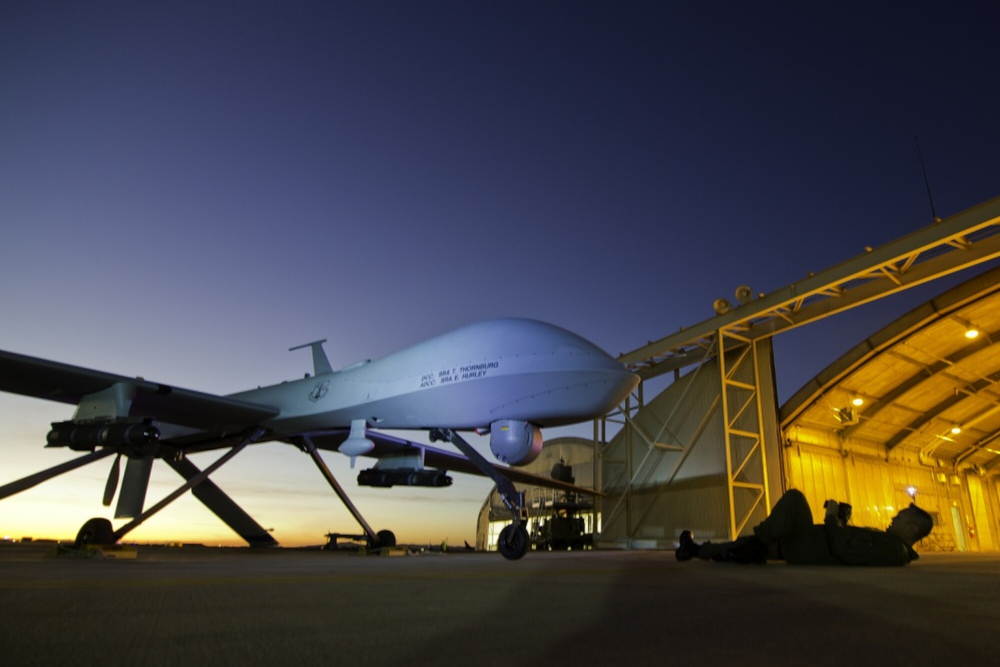 MQ-1 Predator is shown during post-flight inspection at dusk in Victorville, Calif.