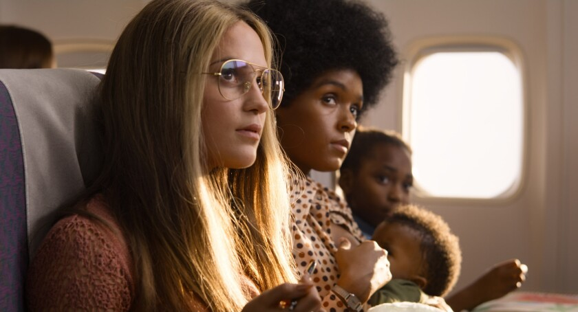 """This image released by LD Entertainment and Roadside Attractions shows Alicia Vikander as Gloria Steinem, left, and Janelle Monae as Dorothy Pitman Hughes in a scene from """"The Glorias,"""" premiering Wednesday on Amazon Prime. (LD Entertainment and Roadside Attractions via AP)"""