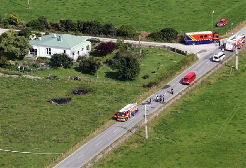 This aerial photo shows the area where a hot air balloon crashed after it caught on fire in Carterton, north of the capital, Wellington, New Zealand, Saturday, Jan. 7, 2012. The hot air balloon crashed and killed all 11 people aboard near the rural New Zealand town some 94 miles (150 kilometers) north of the capital, Wellington, officials said Saturday. (AP Photo/Wairarapa Times, Lynda Feringa) NEW ZEALAND OUT, AUSTRALIA OUT, MANDATORY CREDIT