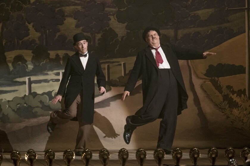 This image released by Sony Pictures Classics shows Steve Coogan as Stan Laurel, left, and John C. R