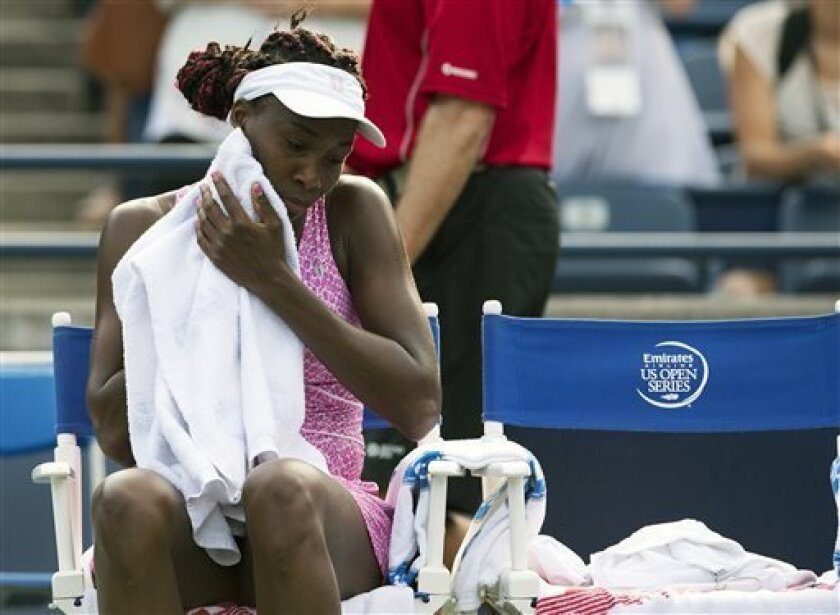 Venus Williams towels off after her loss to Kirsten Flipkens of Belgium following their Rogers Cup women's tennis match in Toronto on Tuesday, Aug. 6, 2013. (AP Photo/The Canadian Press, Frank Gunn)