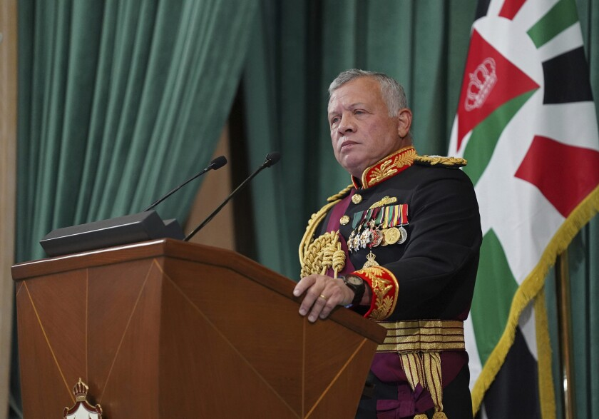 FILE - In this Dec. 10, 2020 file photo released by the Royal Hashemite Court, Jordan's King Abdullah II gives a speech to parliament, in Amman Jordan. Jordan's version of a trial of the century gets under way as early as Monday, June 21, 2021. A relative of King Abdullah II and a former chief of the royal court will be ushered into the defendants' cage at the state security court to face sedition charges. They are accused of conspiring with Prince Hamzah, a half-brother of the king, to foment unrest against the monarch. (Yousef Allan/The Royal Hashemite Court via AP, File)