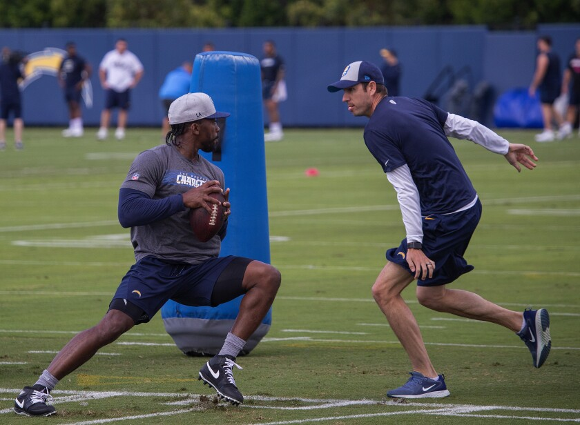Tyrod Taylor goes through a drill at the Chargers' training camp last summer.