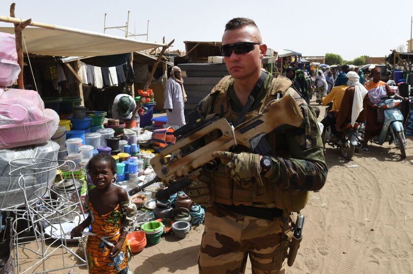 A French soldier of Operation Barkhane, an anti-terrorist operation in the Sahel, patrols at a market in Gao, northern Mali, on May 30.