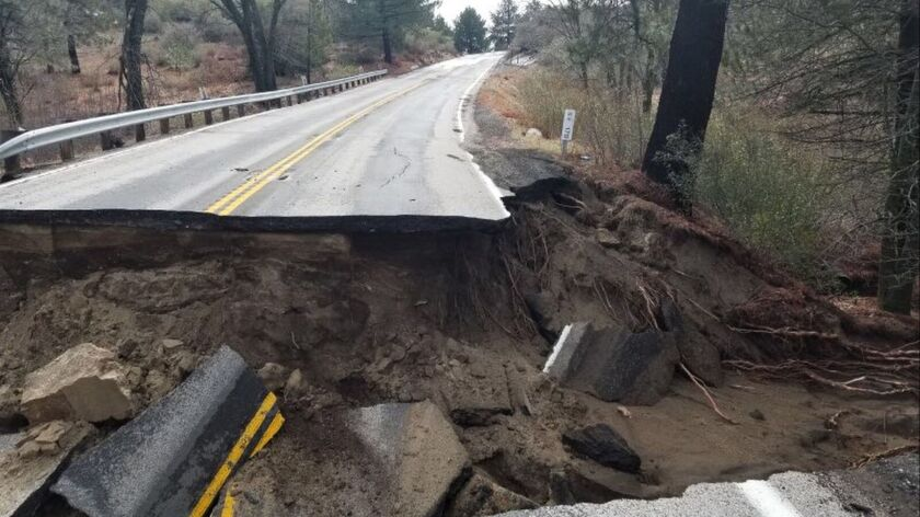 FILE - This Feb. 15, 2019, file photo, released by Caltrans District 8 shows storm damage to the San