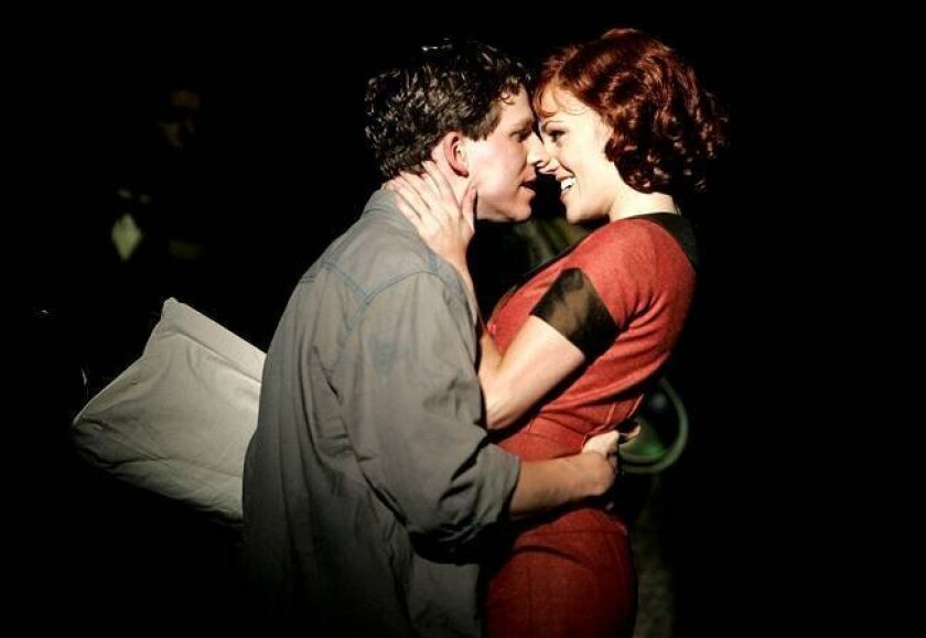 Clyde Barrow (Stark Sands) and Bonnie Parker (Laura Osnes) steal a snuggle in the Playhouse's new musical.