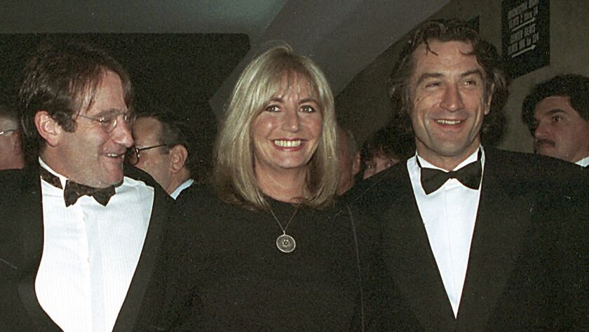 "In this 1990 file photo, director Penny Marshall poses with co-stars of ""Awakenings"" Robin Williams, left, and Robert De Niro at the premiere of the film in New York."