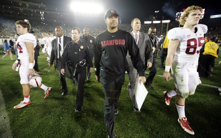 Stanford head coach David Shaw walks off the field after being defeated by Michigan State after the Rose Bowl NCAA college football game on Wednesday, Jan. 1, 2014, in Pasadena, Calif. (AP Photo/Jae C. Hong)