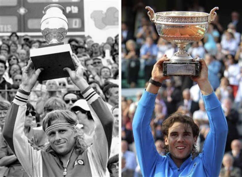 FILE - Sweden's Bjorn Borg raises his trophy after winning the French Open tennis title for a record fifth time at Roland Garros stadium in Paris on June 8, 1980. At right, Spain's Rafael Nadal holds the trophy after defeating Switzerland's Roger Federer Sunday, June 5, 2011 in the men's final of the French Open tennis tournament in Paris. Nadal equaled Bjorn Borg's record of six titles at Roland Garros and earned his 10th career major championship with the 7-5, 7-6 (3), 5-7, 6-1 victory Sunday. (AP Photo/ Michel Euler)