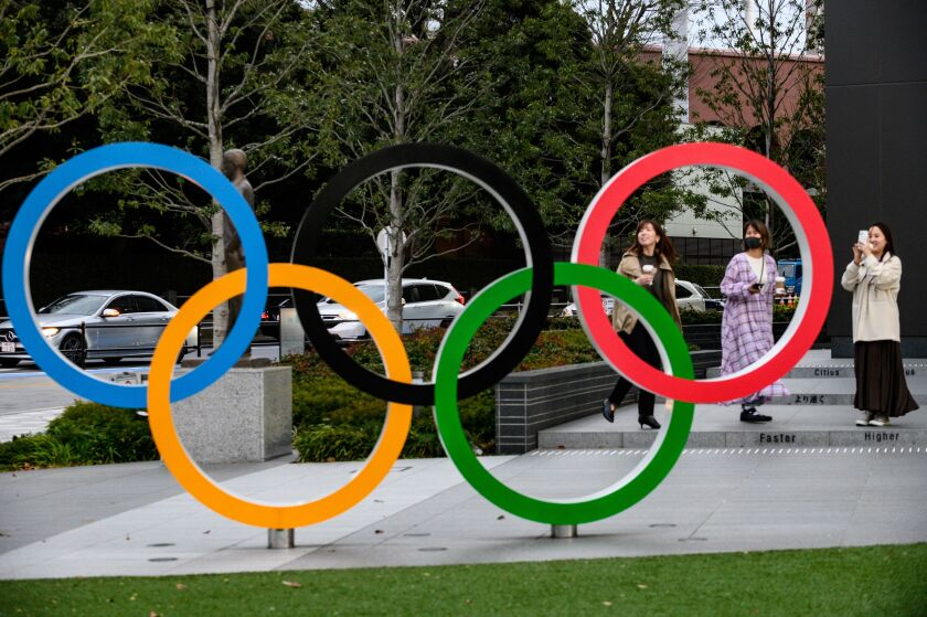 People take pictures of the Olympic Rings