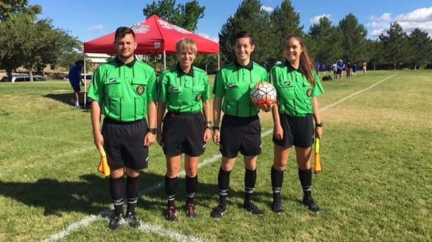 Vanessa Dee gave soccer officiating a try at age 14.